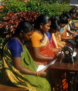 Picture of women reading instructions for operating a sewing machine