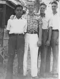 José Chicol, Cakchiquel language teacher, and the three students who made up the first session of SIL classes in 1934.